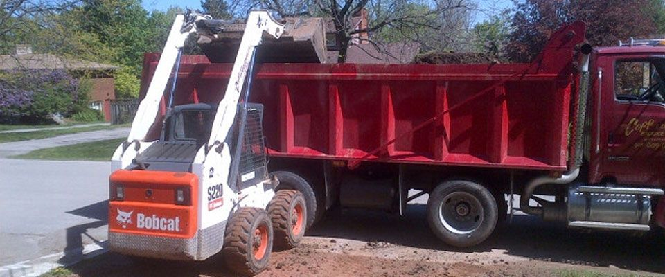 putting dirt into dump truck